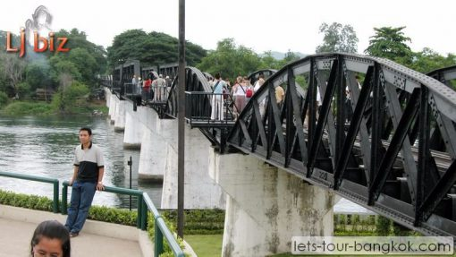 Kanchaburi walking on bridge on river kwai