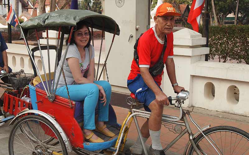 riding tricycle in Nan
